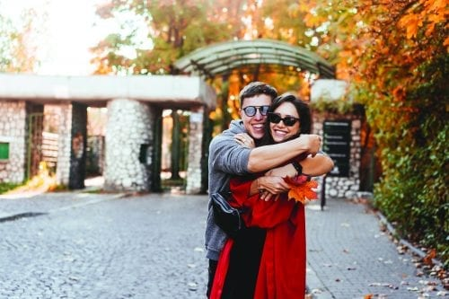 Couple in love walking in the autumn streets